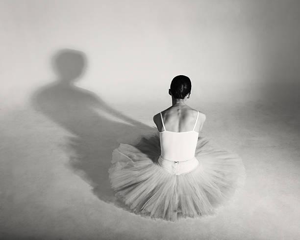 Professional ballerina in tutu posing in studio.